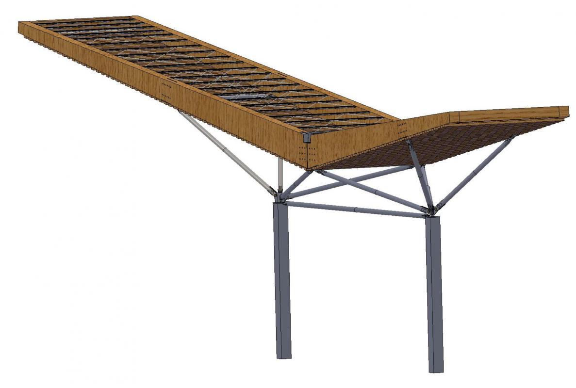 Portique en acier supportant la charpente en bois de la couverture.